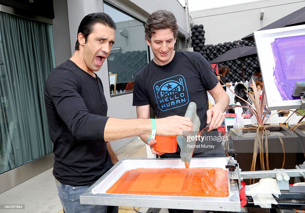 Actor Gilles Marini screen prints tote bags for guests during the Elizabeth Glaser Pediatric AIDS Foundation 26th Annual A Time For Heroes Family...