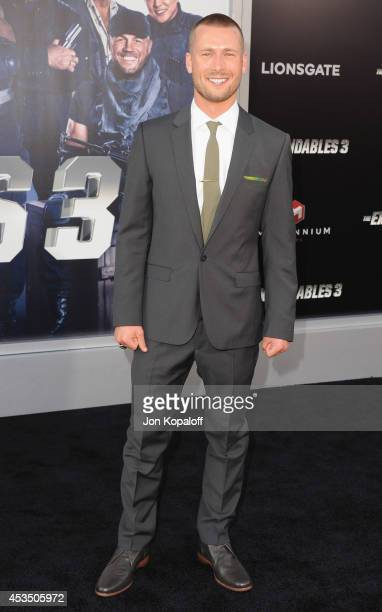 Actor Glen Powell arrives at the Los Angeles Premiere 'The Expendables 3' at TCL Chinese Theatre on August 11 2014 in Hollywood California