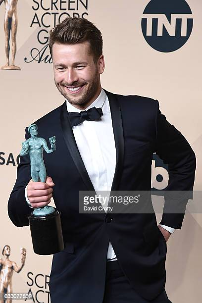 Actor Glen Powell corecipient of the Outstanding Cast in a Motion Picture award for 'Hidden Figures' poses in the press room at the 23rd Annual...