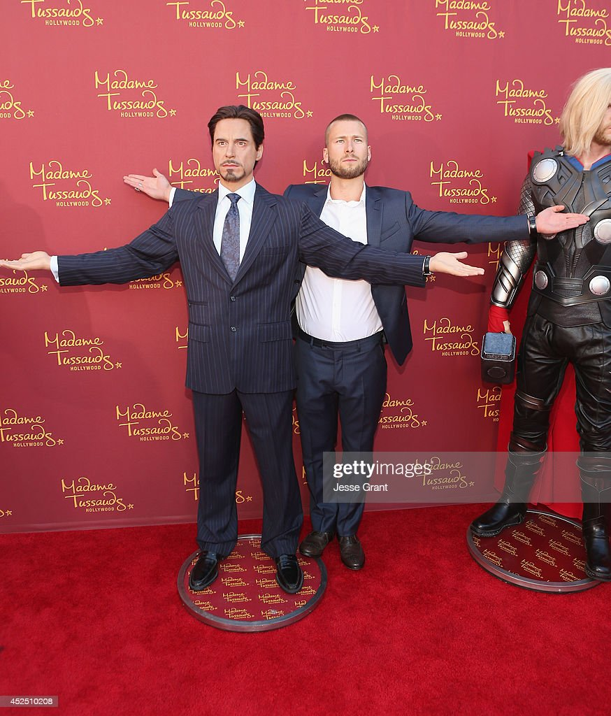 Actor Glen Powell poses alongside a Madame Tussauds Hollywood MARVEL wax figure during the 'Guardians of The Galaxy' premiere at the Dolby Theatre on July 21, 2014 in Hollywood, California.
