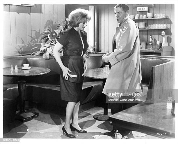 Actor Glenn Ford and actress Rita Hayworth on set of the MGM movie ' The Money Trap' in 1965