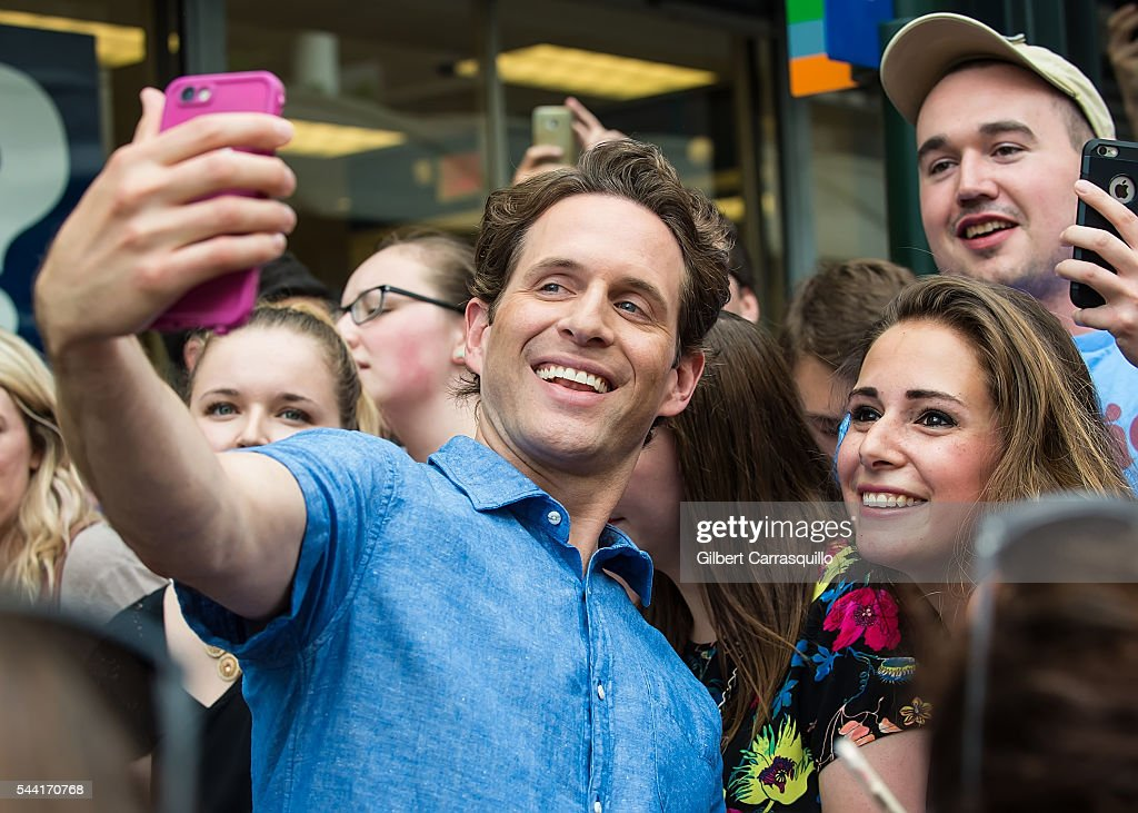 Actor <a gi-track='captionPersonalityLinkClicked' href=/galleries/search?phrase=Glenn+Howerton&family=editorial&specificpeople=537733 ng-click='$event.stopPropagation()'>Glenn Howerton</a> poses with fans during filming scenes of season 12 of 'It's Always Sunny In Philadelphia' sitcom on July 1, 2016 in Philadelphia, Pennsylvania.