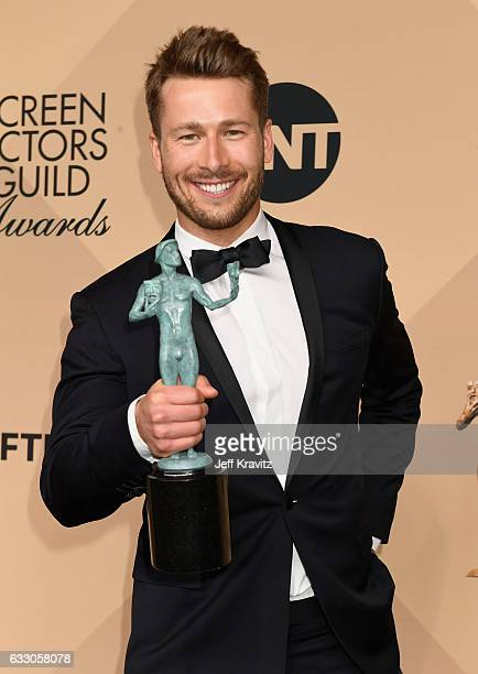 Actor Glenn Powell corecipient of the Outstanding Cast in a Motion Picture award for 'Hidden Figures' poses in the press room during the 23rd Annual...