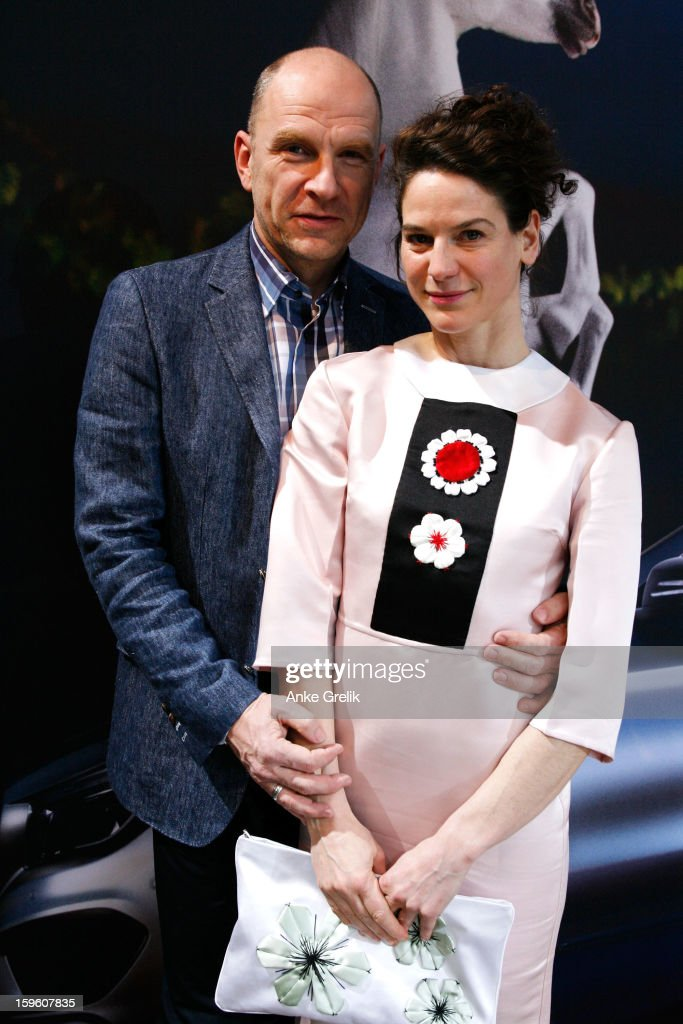 Actor Goetz Schubert and actress Bibiana Beglau attend Mercedes-Benz Fashion Week Autumn/Winter 2013/14 at the Brandenburg Gate on January 17, 2013 in Berlin, Germany.