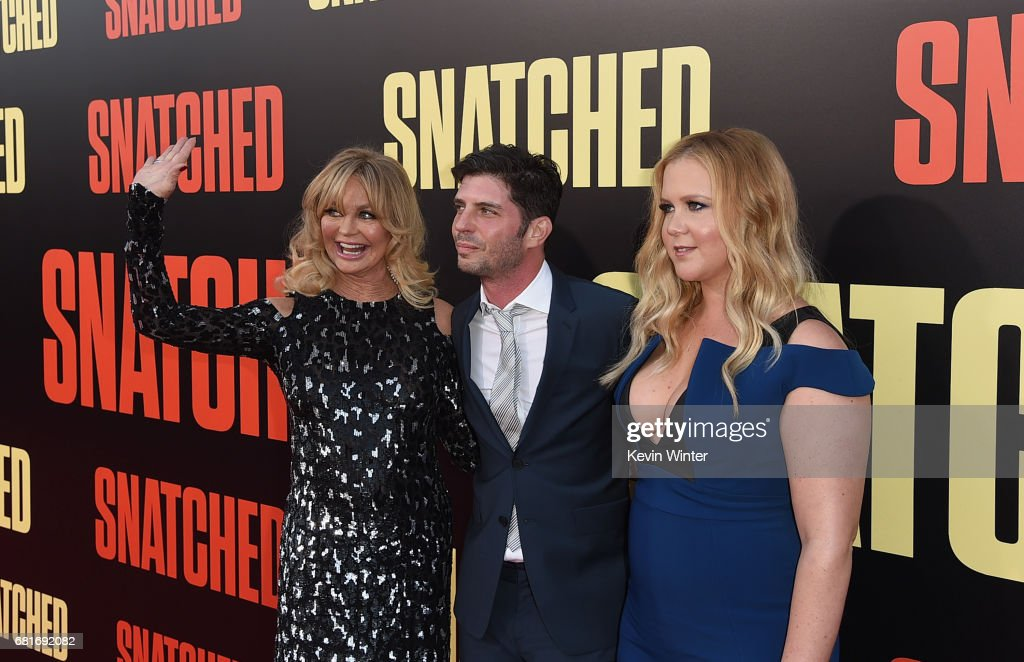 Actor Goldie Hawn, filmmaker Jonathan Levine, and actor/executive producer Amy Schumer attend the premiere of 20th Century Fox's 'Snatched' at Regency Village Theatre on May 10, 2017 in Westwood, California.