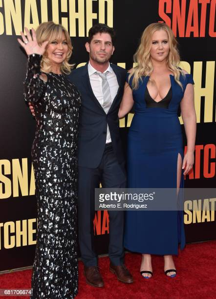 Actor Goldie Hawn filmmaker Jonathan Levine and actor/executive producer Amy Schumer attend the premiere of 20th Century Fox's 'Snatched' at Regency...