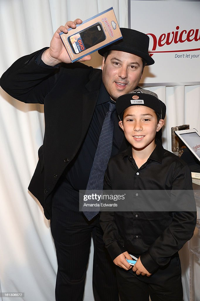 Actor <a gi-track='captionPersonalityLinkClicked' href=/galleries/search?phrase=Greg+Grunberg&family=editorial&specificpeople=561118 ng-click='$event.stopPropagation()'>Greg Grunberg</a> and son Sam Grunberg attend the GRAMMY Gift Lounge during the 55th Annual GRAMMY Awards at STAPLES Center on February 9, 2013 in Los Angeles, California.