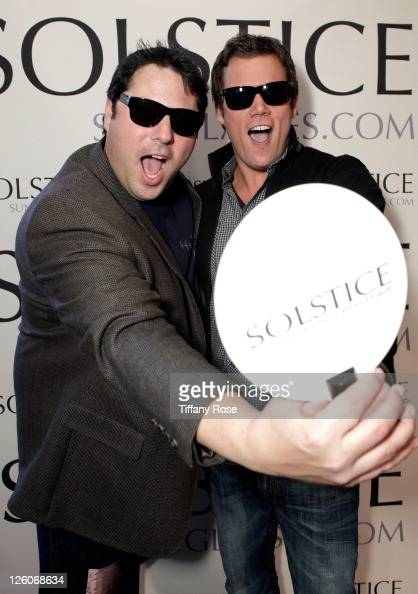 Actor Greg Grunberg in Giorgio Armani 770s sunglasses and TV personality Bob Guiney in Tommy Hilfiger 1016s sunglasses pose at the...