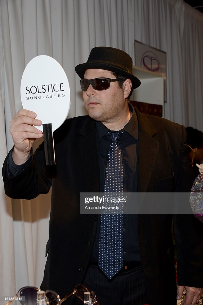 Actor Greg Grunberg in Hugo Boss HB0423PS sunglasses poses with SOLSTICE Sunglasses and Safilo USA during the 55th Annual GRAMMY Awards at the STAPLES Center on February 9, 2013 in Los Angeles, California.