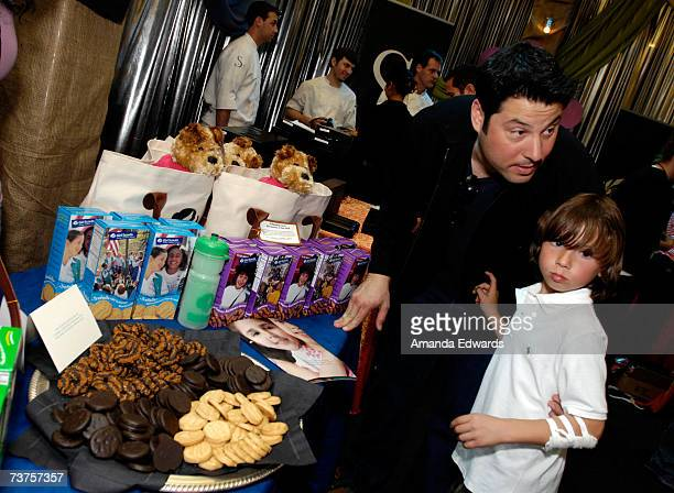 Actor Greg Grunberg with his kid at the Girls Scouts display in the Distinctive Assets gift lounge during the 20th annual Kid's Choice Awards at...