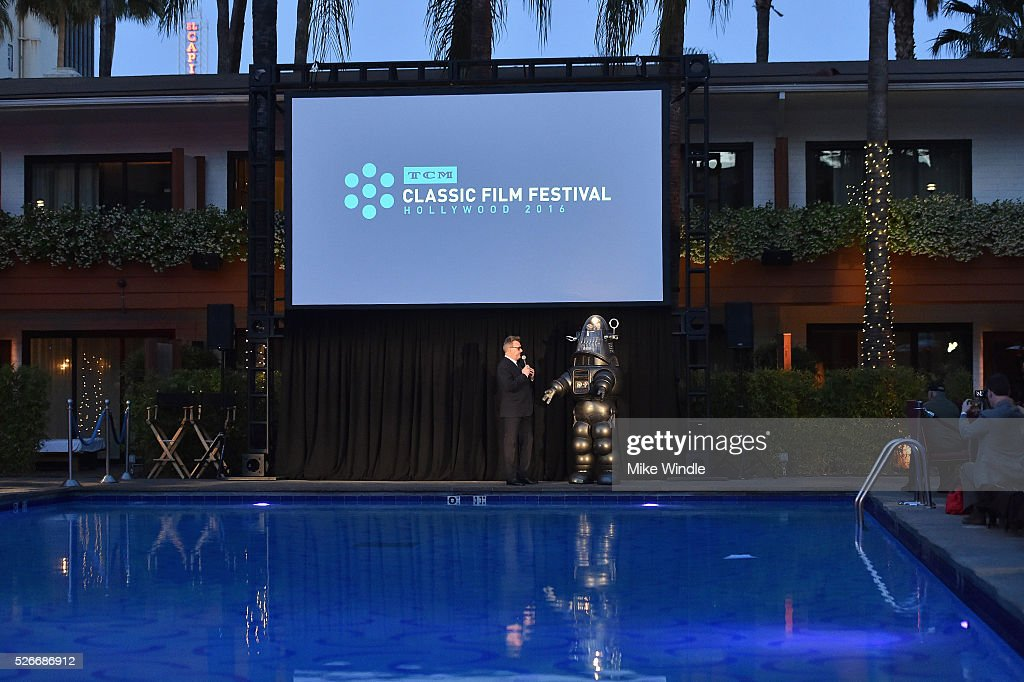 Image was shot in HDR.) LOS ANGELES, CA - APRIL 30: Actor Greg Proops (L) and Robby the Robot speak onstage at 'Forbidden Planet' screening during day 3 of the TCM Classic Film Festival 2016 on April 30, 2016 in Los Angeles, California. 25826_008