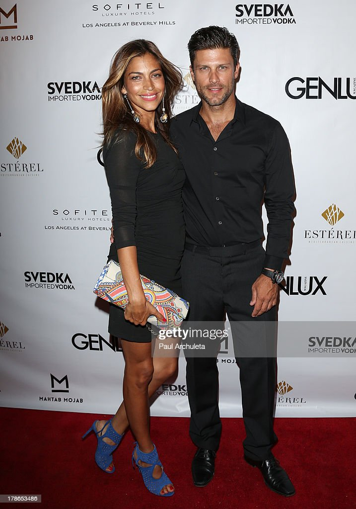 Actor Greg Vaughan (R) and his wife Touriya Vaughan (L) attend the Genlux Magazine release party at Sofitel Hotel on August 29, 2013 in Los Angeles, California.
