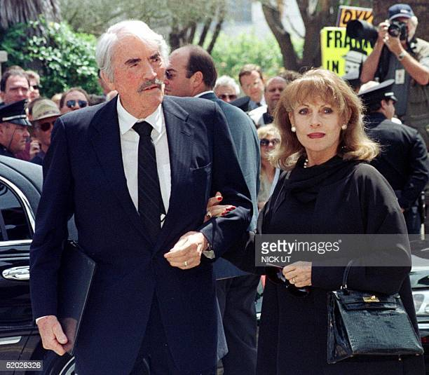Actor Gregory Peck accompanied by his wife Veronique arrive for the funeral of legendary entertainer Frank Sinatra at the Good Shepard Catholic...