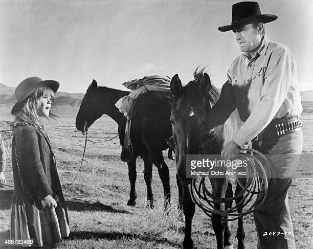 Actor Gregory Peck and actress Dawn Lyn on set of the movie 'Shoot Out' circa 1971