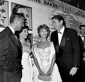 Actor Gregory Peck and his wife Veronique Passani with actress Jean Simmons and Stewart Granger attend the premiere of 'The Big Country' in Los...