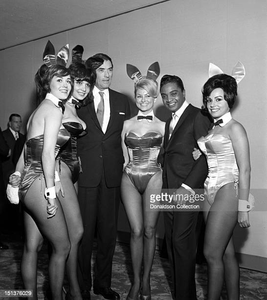 Actor Gregory Peck and rock and roll singer Jackie Wilson poses for a portrait with a group of Playboy Bunnies at a dinner for the Motion Picture...
