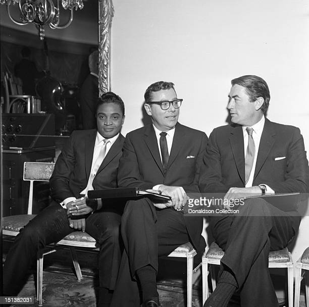 Actor Gregory Peck and singer Jackie Wilson with another man at a dinner for the Motion Picture Pioneers Association at the Playboy Club on November...
