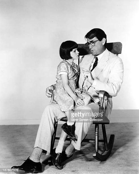 Actor Gregory Peck as Atticus Finch and Mary Badham as Jean Louise 'Scout' Finch in a publicity still for the film 'To Kill a Mockingbird' 1962