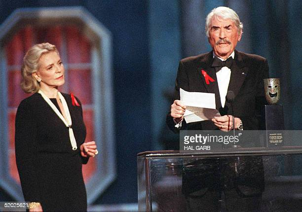 Actor Gregory Peck reads a letter from actress Elizabeth Taylor who was awarded a lifetime achievement award at the 4th Annual Screen Actor Guild...