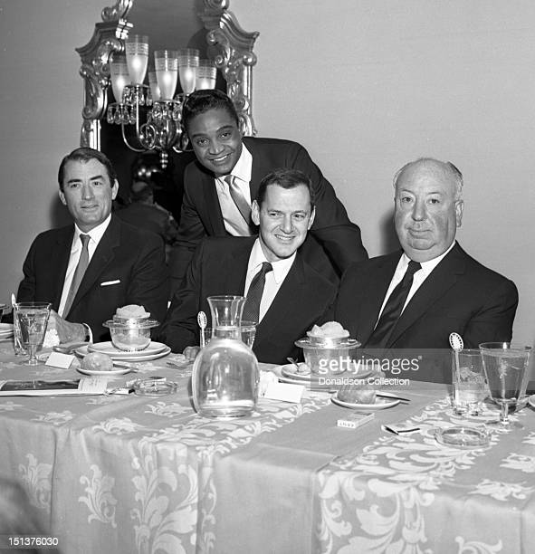 Actor Gregory Peck rock and roll singer Jackie Wilson actor Tony Randall and director Alfred Hitchcock and pose for a portrait at a dinner for the...