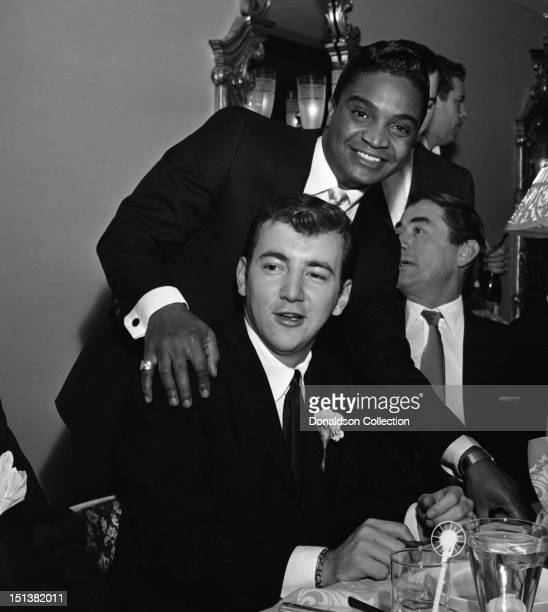 Actor Gregory Peck rock and roll singer Jackie Wilson and singer Bobby Darin at a dinner for the Motion Picture Pioneers Association at the Playboy...