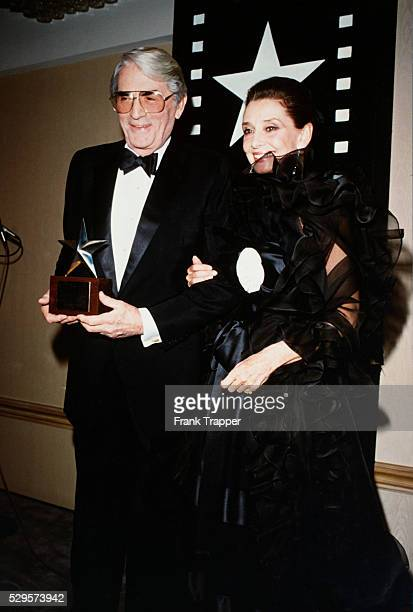 Actor Gregory Peck seen here with Audrey Hepburn received the American Film Institute Life Achievement Award in honor of his fiftyyear careera