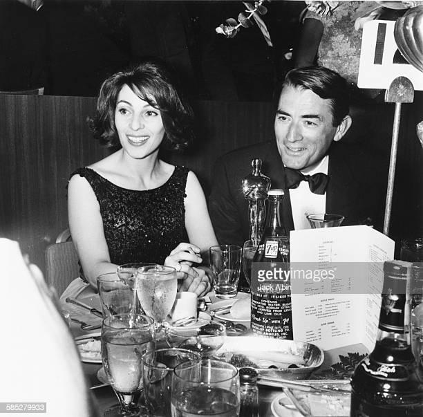 Actor Gregory Peck sitting with his wife and his Oscar for his role in the film 'To Kill a Mockingbird' at the 35th Academy Awards Los Angeles April...