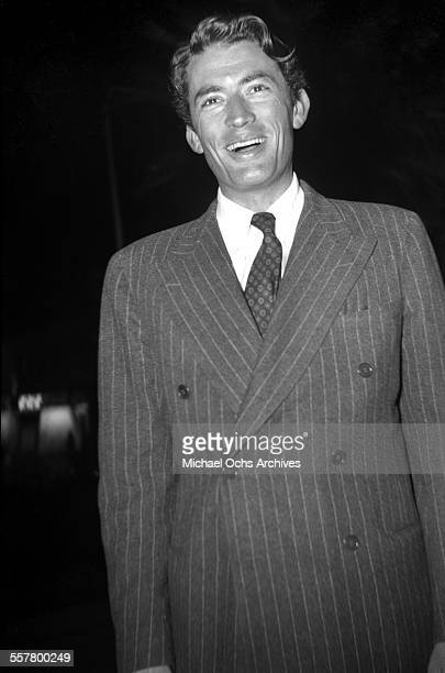 Actor Gregory Peck smiles as he poses in Los Angeles California
