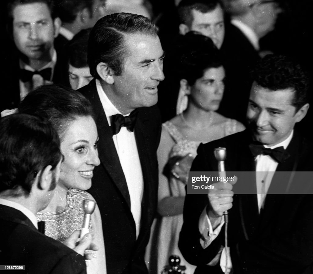 Actor Gregory Peck, wife Veronique Passani and television personality Regis Philbin attending the premiere of 'Sweet Charity' on March 28, 1969 in Hollywood, California.