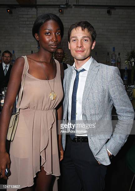 Actor Gregory Smith and guest attend 'A Dangerous Method' party hosted by GREY GOOSE Vodka at Soho House Pop Up Club during the 2011 Toronto...