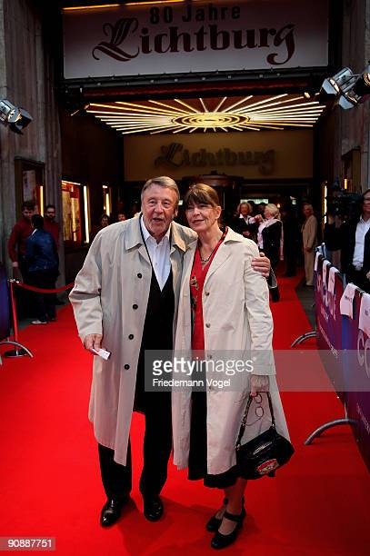 Actor Guenter Lamprecht and partner Claudia Amm pose on the red carpet as they arrives for the premiere of the film 'Vision From The Life Of...