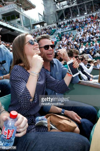 Actor Guillaume de Tonquedec and his daughter Victoire attend the 2017 French Tennis Open Day Thirteen at Roland Garros on June 9 2017 in Paris France