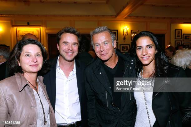 Actor Guillaume de Tonquedec with his wife Christelle and humorist Franck Dubosc with his wife Danielle Dubosc after 'Nina' Premiere at Theatre...