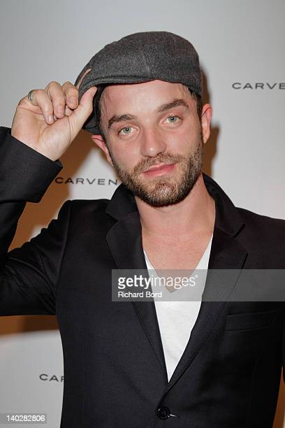 Actor Guillaume Gouix attends the Carven Party Photocall as part of Paris Fashion Week at Pavillon Vendome on March 1 2012 in Paris France