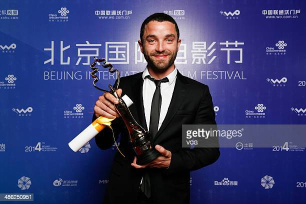 Actor Guillaume Gouix poses with his trophy at the closing ceremony during 2014 Beijing International Film Festival at BTV Theater on April 23 2014...