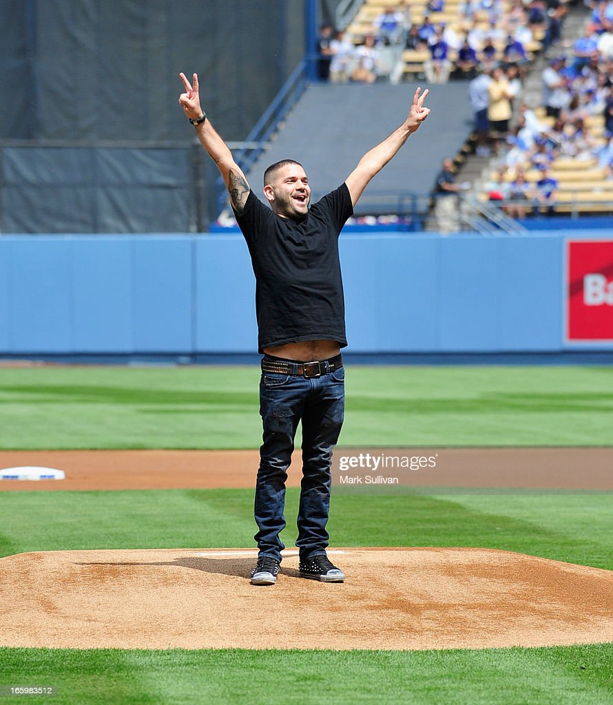 Actor Guillermo Diaz throws out the ceremonial first pitch before the LA Dodgers vs Pittsburg Pirate game at Dodger Stadium on April 7, 2013 in Los Angeles, California.