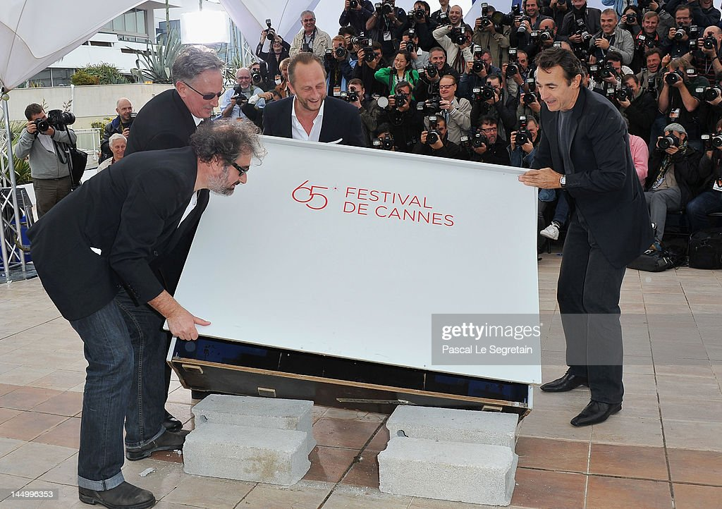 Actor Gustave Kerven, director Benoit Delepine, actor Benoit Poelvoorde and actor <a gi-track='captionPersonalityLinkClicked' href=/galleries/search?phrase=Albert+Dupontel&family=editorial&specificpeople=3096344 ng-click='$event.stopPropagation()'>Albert Dupontel</a> pose at the 'Le Grand Soir' photocall during the 65th Annual Cannes Film Festival at Palais des Festivals on May 22, 2012 in Cannes, France.