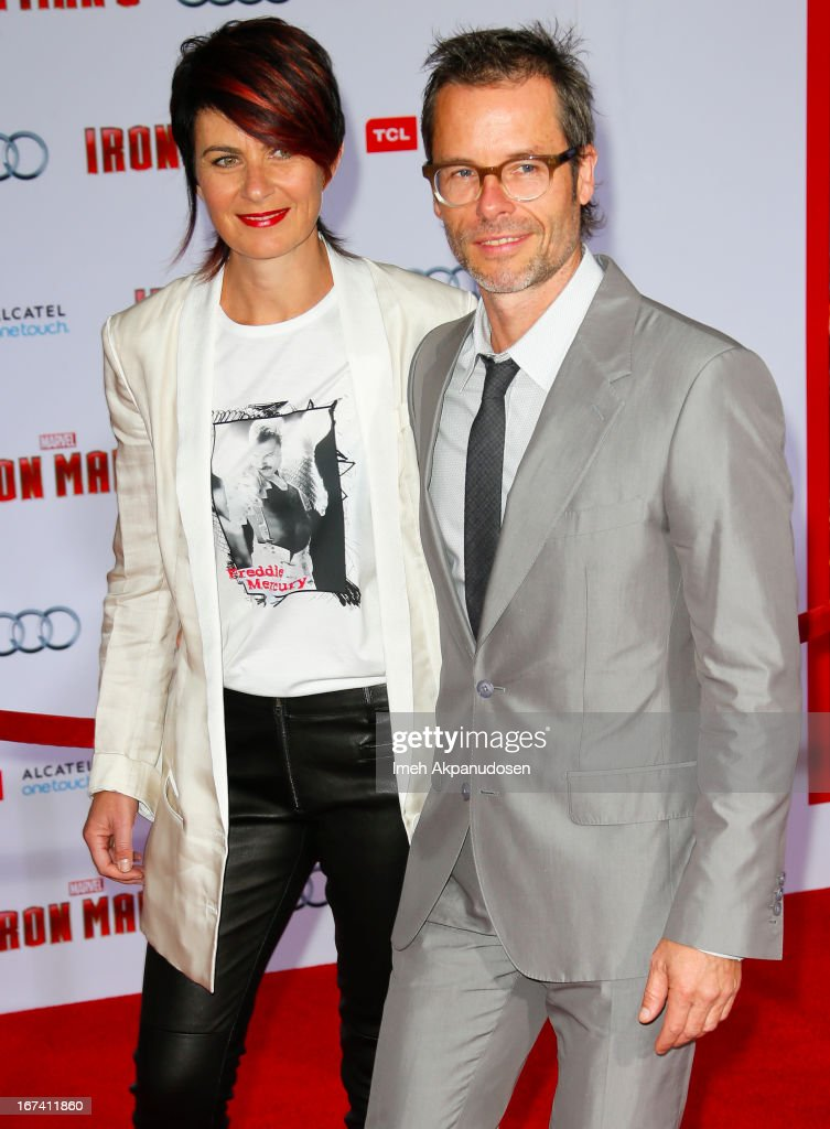 Actor Guy Pearce (R) and his wife, Kate Mestitz, attend the premiere of Walt Disney Pictures' 'Iron Man 3' at the El Capitan Theatre on April 24, 2013 in Hollywood, California.