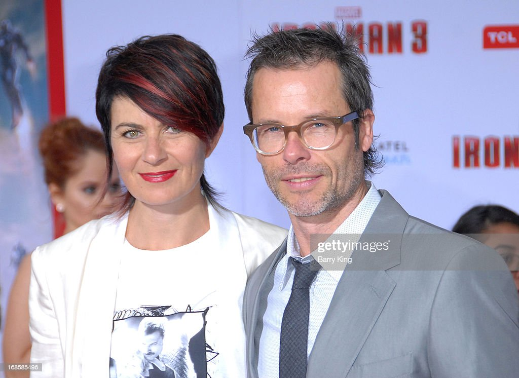Actor Guy Pearce (R) and wife Kate Mestitz arrive at the Los Angeles Premiere 'Iron Man 3' at the El Capitan Theatre on April 24, 2013 in Hollywood, California.