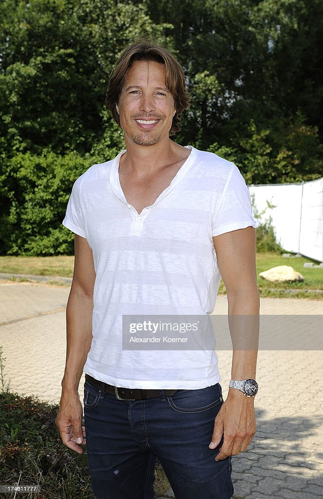 Actor Hakim Michael is beeing pictured during the 'Rote Rosen Fan-Tag 2013' on July 28, 2013 in Luneburg, Germany. More than 3500 fans of the daily television telenovela 'Rote Rosen' came to see the Studios and to meet their favorite actor.