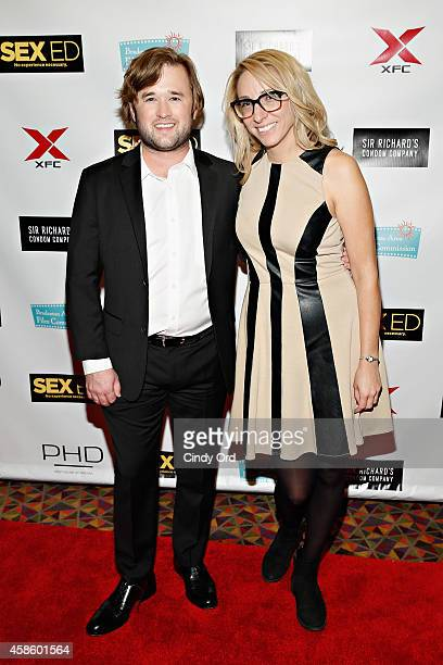 Actor Haley Joel Osment and coproducer Jennifer Glynn attend the 'Sex Ed' New York Premiere at AMC Empire 25 theater on November 7 2014 in New York...