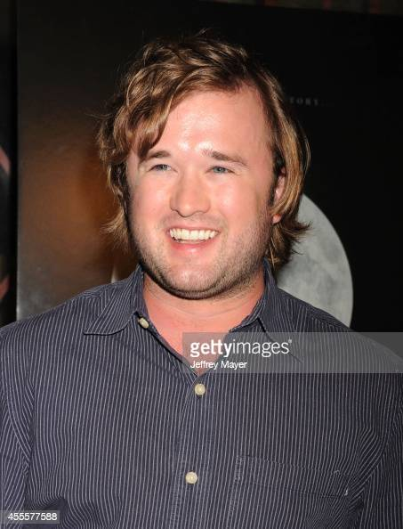 Actor Haley Joel Osment arrives at the Los Angeles premiere of 'Tusk' at the Vista Theatre on September 16 2014 in Los Angeles California