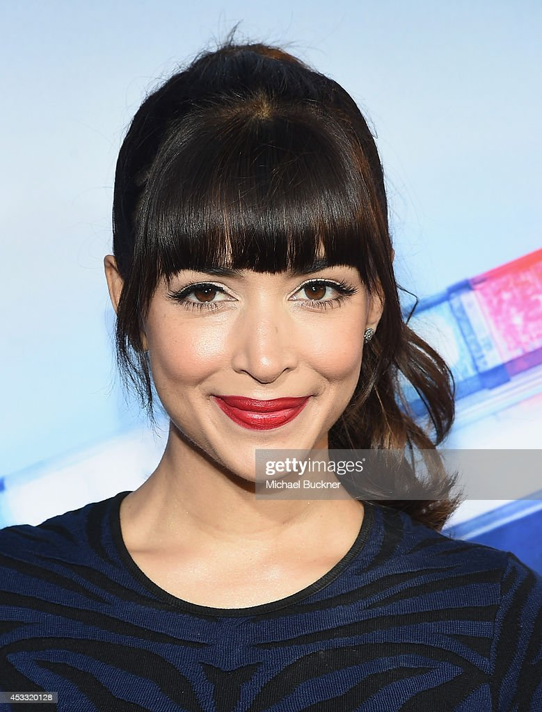 Actor <a gi-track='captionPersonalityLinkClicked' href=/galleries/search?phrase=Hannah+Simone&family=editorial&specificpeople=3291351 ng-click='$event.stopPropagation()'>Hannah Simone</a> arrives at the premiere of Twentieth Century Fox's 'Let's Be Cops' at ArcLight Hollywood on August 7, 2014 in Hollywood, California.