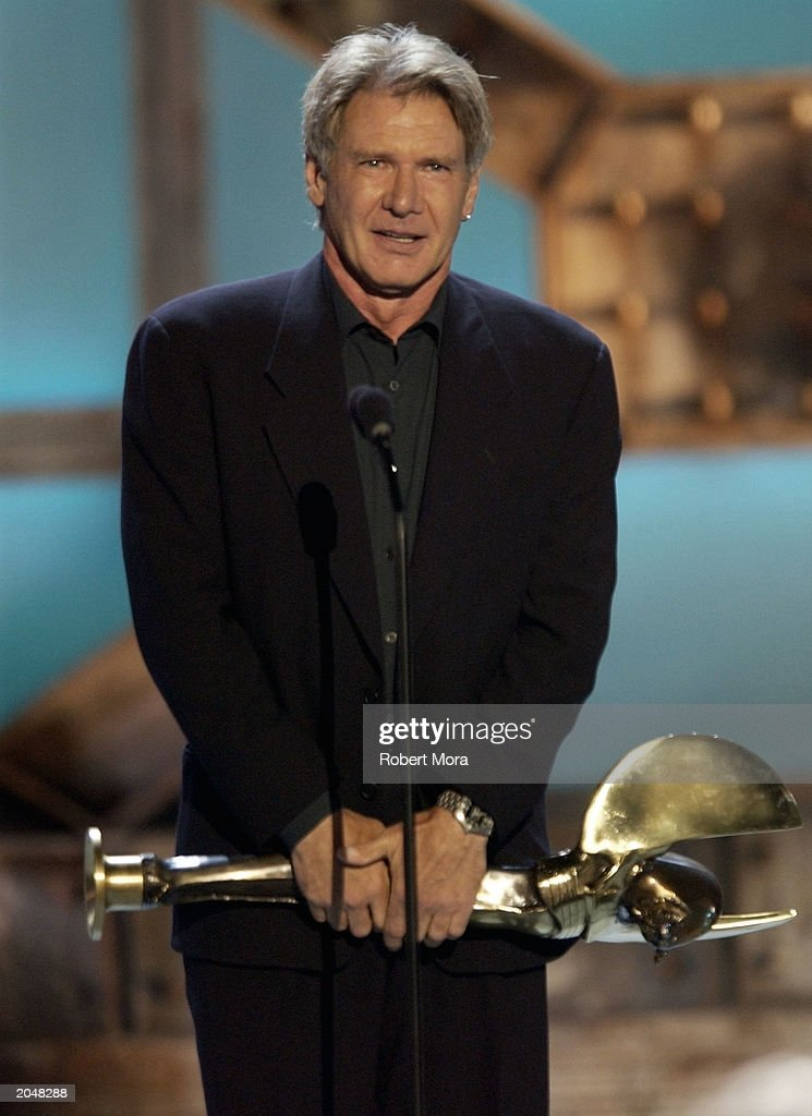 Actor <a gi-track='captionPersonalityLinkClicked' href=/galleries/search?phrase=Harrison+Ford+-+Actor+-+Born+1942&family=editorial&specificpeople=11508906 ng-click='$event.stopPropagation()'>Harrison Ford</a> accepts the Taurus Honorary Award Outstanding Achievement on stage during the 3rd Annual Taurus World Stunt Awards at Paramount Studios June 1, 2003 in Hollywood, California. The show will air Monday, June 9th, 8:00 pm EST/PST on the USA Network.
