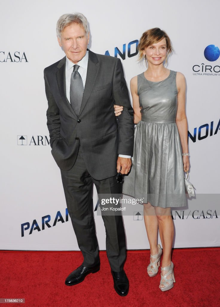 Actor Harrison Ford and actress Calista Flockhart arrive at the Los Angeles Premiere 'Paranoia' at DGA Theater on August 8, 2013 in Los Angeles, California.