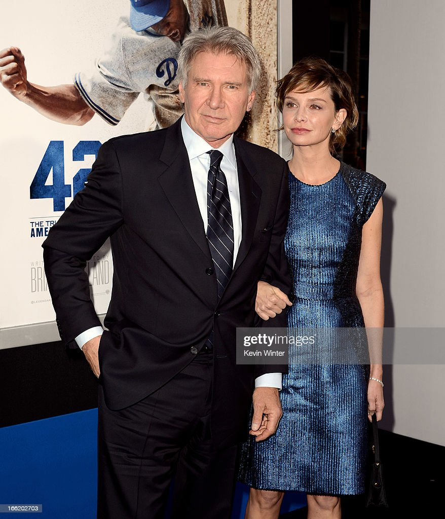 Actor Harrison Ford (L) and his wife actress Calista Flockhart arrive at the premiere of Warner Bros. Pictures' and Legendary Pictures' '42' at the Chinese Theatre on April 9, 2013 in Los Angeles, California.