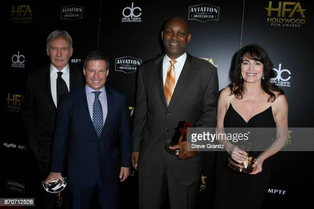 Actor Harrison Ford and honorees Andrew A Kosove Broderick Johnson and Cynthia Sikes Yorkin recipients of the Hollywood Producer Award for 'Blade...