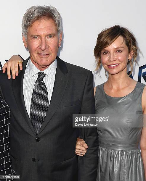 Actor Harrison Ford and wife actress Calista Flockhart attend the premiere of Relativity Media's 'Paranoia' at the DGA Theater on August 8 2013 in...