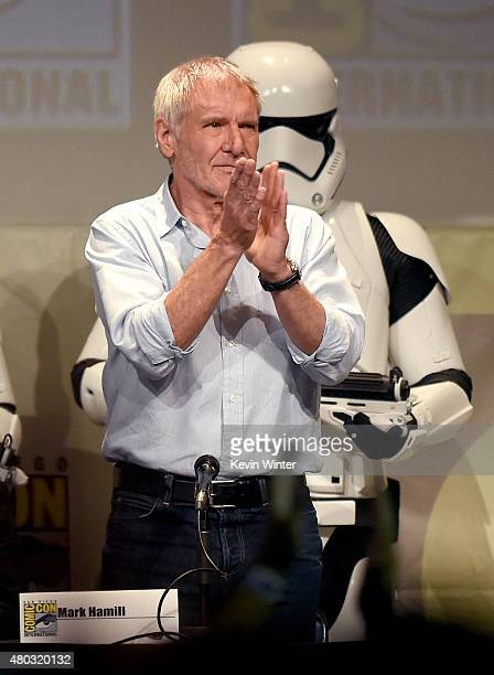 Actor Harrison Ford applauds onstage at the Lucasfilm panel during ComicCon International 2015 at the San Diego Convention Center on July 10 2015 in...