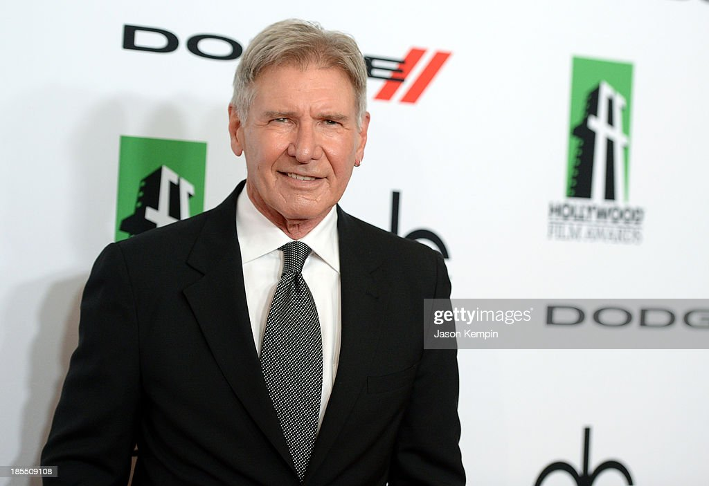 Actor <a gi-track='captionPersonalityLinkClicked' href=/galleries/search?phrase=Harrison+Ford+-+Actor+-+Born+1942&family=editorial&specificpeople=11508906 ng-click='$event.stopPropagation()'>Harrison Ford</a> arrives at the 17th annual Hollywood Film Awards at The Beverly Hilton Hotel on October 21, 2013 in Beverly Hills, California.